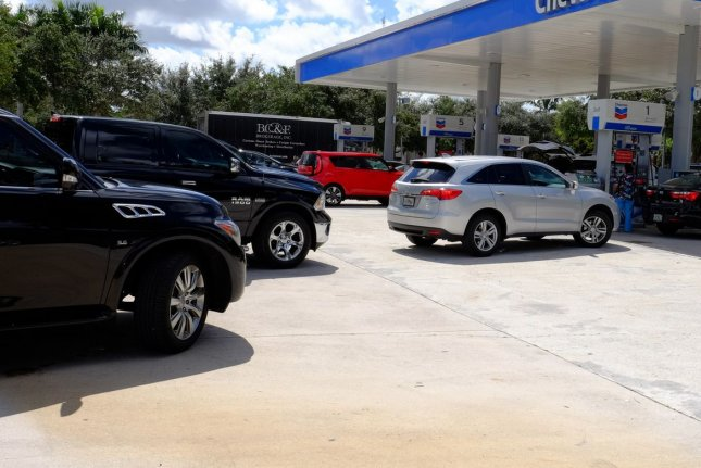 Retail gasoline prices relatively unchanged for most of February, but that will change as refiners shift to a more expensive blend of gasoline. Photo by Gary I Rothstein/UPI.
