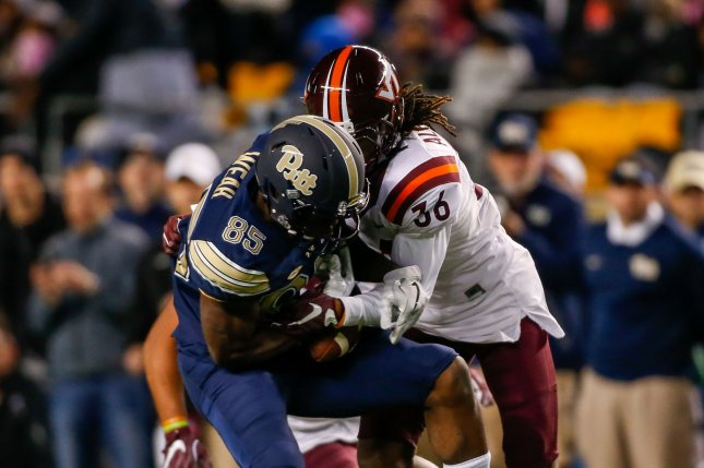 Pittsburgh Panthers wide receiver Jester Weah (85) is tackled by Virginia Tech Hokies cornerback Adonis Alexander (36) in the second quarter on October 27, 2016 in Pittsburgh. File photo by Matt Durisko/UPI