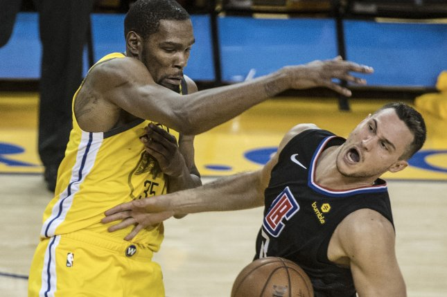 Warriors forward Kevin Durant commits a foul on Clippers forward Danilo Gallinari in the NBA playoffs Thursday at Oracle Arena in Oakland, Calif. Durant and the Clippers JaMychal Green have had technical fouls rescinded from Game 3. Photo by Terry Schmitt/UPI