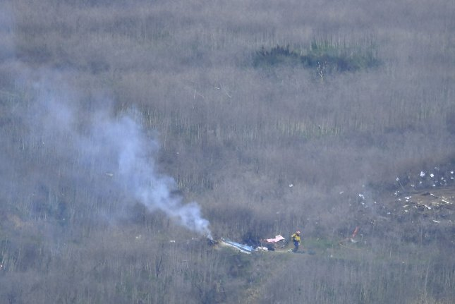 Smoldering wreckage from a helicopter crash is seen on a hillside in Calabasas, Calif., on January 26, 2020. The crash killed NBA legend Kobe Bryant, his daughter Gianna and seven others. File Photo by John McCoy/UPI