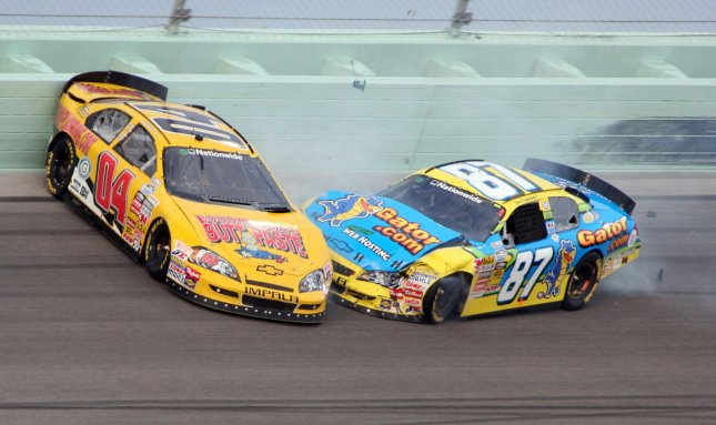 Joe Nemechek (87) hits Jeremy Clements (4) in turn four during the NASCAR Nationwide series Ford 300 at Homestead-Miami Speedway in Homestead, Florida on November 19, 2010. UPI/Malcolm Hope
