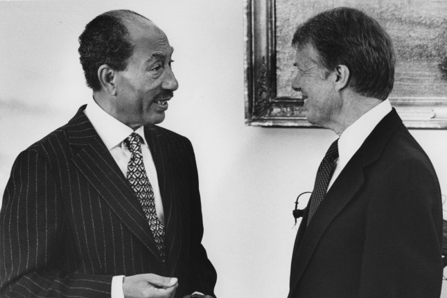Egyptian president Anwar Sadat and US President Jimmy Carter confer in the Oval Office of the White House in Washington prior to the peace treaty signing on March 26, 1979. File photo UPI