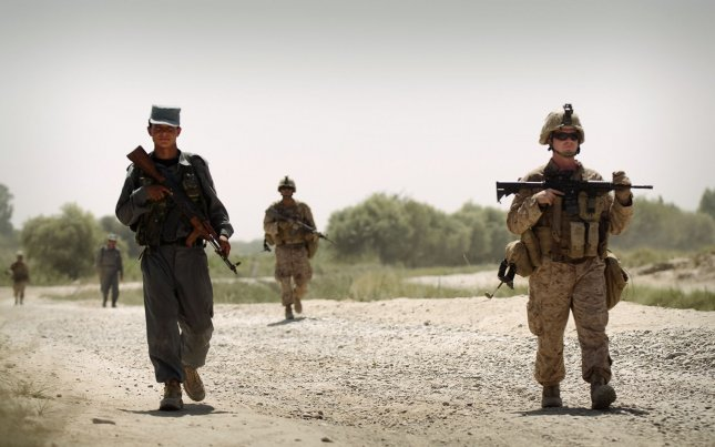Sgt. Christopher Conaway (R), a squad leader with Kilo Company, 3rd Battalion, 3rd Marine Regiment, leads his squad and Afghan National Police officer partners on a brief patrol back to Patrol Base Jaker after manning a vehicle checkpoint as part of security for the Nawa District bazaar in Helmand province, Afghanistan on September 3, 2010. UPI/Mark Fayloga/U.S. Marines