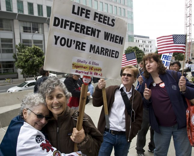 Shelly Bailes and Ellen Ponyac (L) hug outside the San Francisco Federal Building as they wait for a federal judge's ruling on California's gay-marriage ban in San Francisco on August 4, 2010. UPI/Terry Schmitt