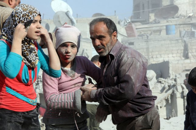 A man and his daughters look for relatives in the rubble of destroyed houses after an airstrike in the rebel-held area of Kallasah on the outskirts of Aleppo, Syria, last October. According to the Syrian Observatory for Human Rights, more than 70 people were killed and over a hundred wounded in the attacks on the busy market in Damascus and houses in Aleppo. Photos by Ameer Alhalbi/ UPI