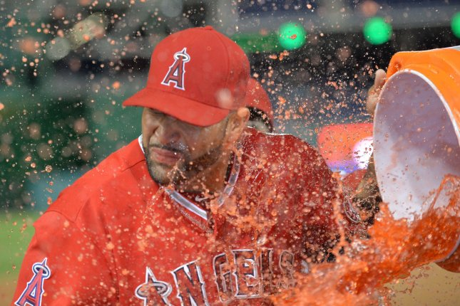 Los Angeles Angles' Albert Pujols is dunked with sports drink. UPI/Kevin Dietsch