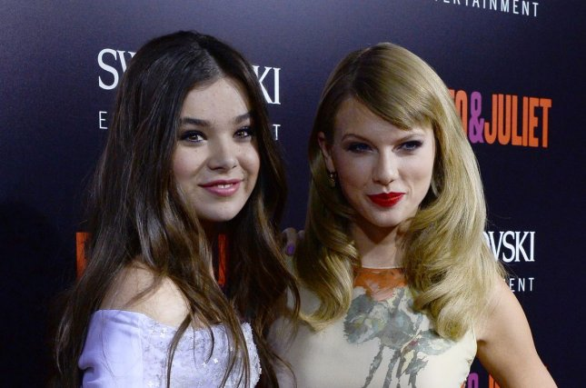 Hailee Steinfeld (L) and Taylor Swift at the Los Angeles premiere of Romeo and Juliet on September 24, 2013. File Photo by Jim Ruymen/UPI