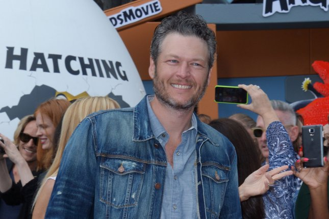 Blake Shelton attending the premiere of The Angry Birds Movie on May 7, 2016. Shelton, along with his Voice Season 11 judges Adam Levine, Miley Cyrus and Alicia Keys, performed Dream On in memory of slain former Voice contestant Christina Grimmie. File Photo by Jim Ruymen/UPI