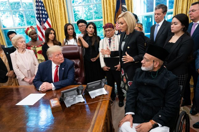 Paula White speaks as President Donald Trump met with a group of survivors of religious persecution in the Oval Office at the White House on Wednesday. Photo by Kevin Dietsch/UPI