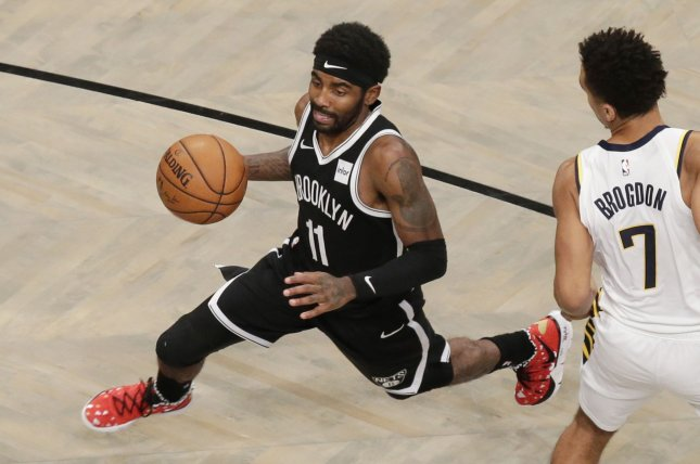 Brooklyn Nets guard Kyrie Irving (11) drives to the basket past Indiana Pacers guard Malcolm Brogdon in the first half Wednesday at Barclays Center in New York City. Photo by John Angelillo/UPI