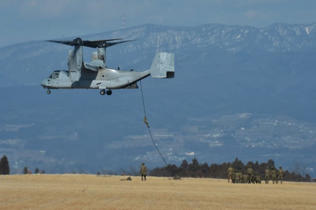 Members of the Japan's Ground Self-Defense Force, 30th Infantry Regiment, 12th Brigade fast rope from a MV-22 Osprey during a joint military exercise with U.S. forces in 2017. On Tuesday Bell Boeing announced the first modified versions of the aircraft were available. Photo by Keizo Mori/UPI