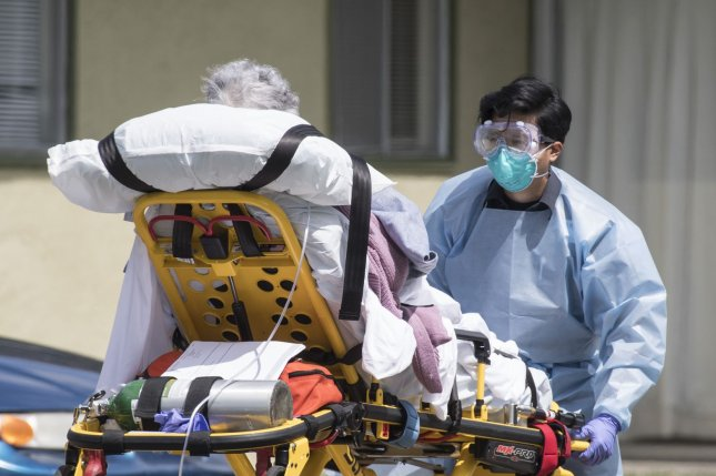 A patient is moved out of a nursing home in California. In New Jersey, the Andover Subacute and Rehabilitation II facility faces a fine for multiple violations. Photo by Terry Schmitt/UPI