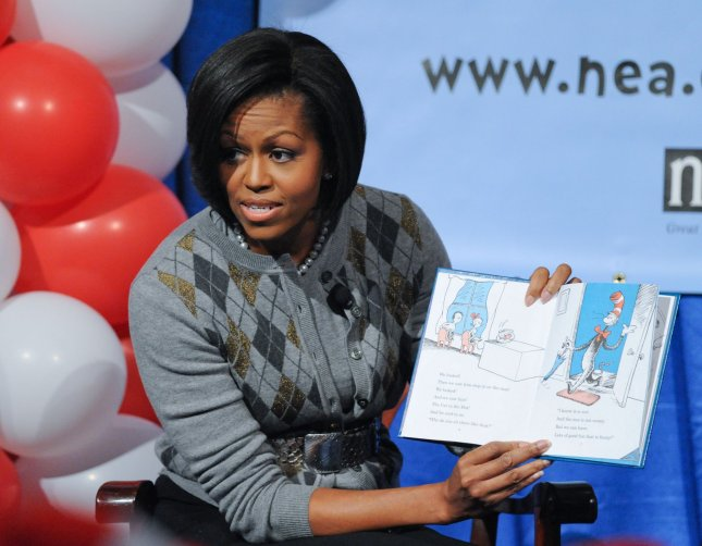 First Lady Michelle Obama reads 'The Cat in the Hat' to high school seniors. (Just a joke) UPI/Alexis C. Glenn