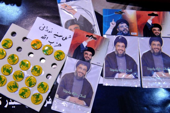 Car-fresheners with a picture of Sheikh Hassan Nasrallah are displayed during International Koran Exhibition at the Imam Khomeini Grand mosque during the holy month of Ramadan on August 16, 2010 in Tehran, Iran. UPI/Maryam Rahmanian.