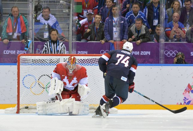 Team USA's T.J. Oshie scores the game winning goal against Russian goaltender Sergei Bobrovski in their preliminary round game during the Sochi 2014 Winter Olympics in Sochi, Russia, Feb. 15, 2014. UPI/Kevin Dietsch