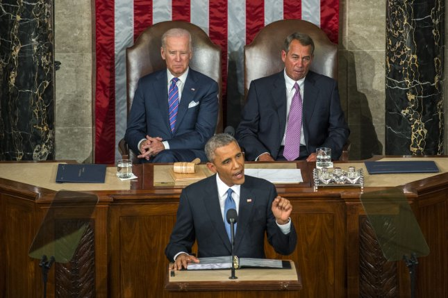 Vice President and President of the Senate Joe Biden (L) and Republican Speaker of the House John Boehner sit behind U.S. President Barack Obama as he delivers his State of the Union address to a joint session of congress and the American people in the House Chamber at the U.S. Capitol on January 20, 2015 in Washington, DC. Obama vowed to help the middle class. Photo by Pat Benic/UPI