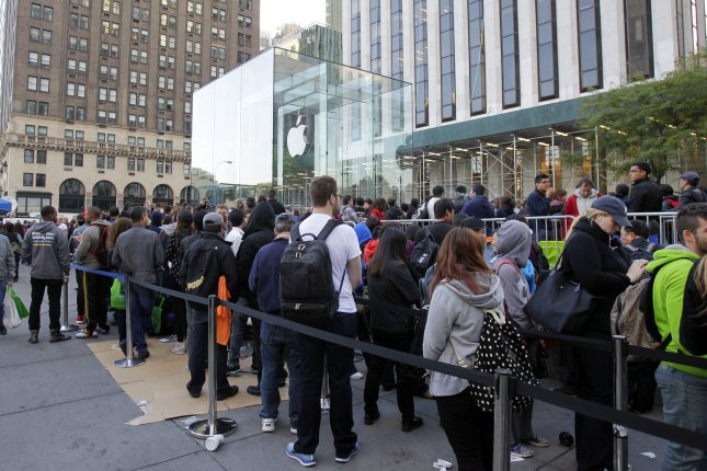 The first customers stand in line to purchase the iPhone 5S and 5C on Sept. 20, 2013, at the Apple Store on 5th Avenue in New York City. Customers may soon be standing in line again to buy the anticipated iPhone 6S, which is likely to be announced Sept. 9. File photo by John Angelillo/UPI