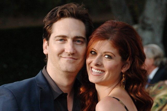 Debra Messing (R) and Daniel Zelman at the Los Angeles premiere of Open Season on September 25, 2006. The couple were officially divorced Tuesday. File Photo by Jim Ruymen/UPI