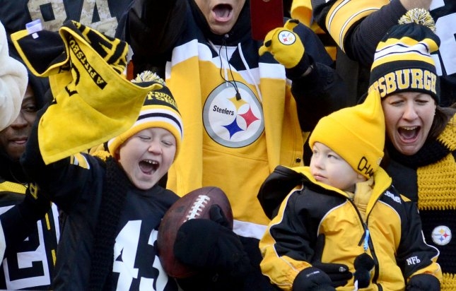 A young fan reacts after receiving the football from Pittsburgh Steelers wide receiver Cobi Hamilton at Heinz Field in Pittsburgh on January 1, 2017. File Photo by Archie Carpenter/UPI