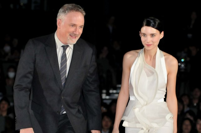 Actress Rooney Mara and director David Fincher attend the Japan premiere for the film The Girl with the Dragon Tattoo in Tokyo on January 30, 2012. Fincher and Mara will not return for the sequel The Girl in the Spider's Web. File Photo by Keizo Mori/UPI