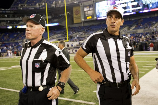 NFL officials Gene Steratore (R) and Bob Waggone talk on the field prior to the Baltimore Ravens game against the Cleveland Browns on September 27, 2012 at M&T Bank Stadium in Baltimore, Maryland. File photo by Kevin Dietsch/UPI