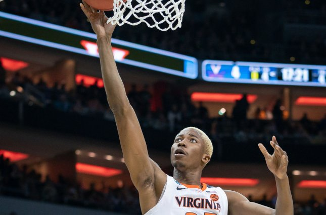 Virginia Cavaliers forward Mamadi Diakite (25) shoots the ball March 30 during the regional final of 2019 NCAA Division I Men's Basketball tournament against the Purdue Boilermakers at the KFC Yum Center in Louisville, Kentucky. Photo by Bryan Woolston/UPI