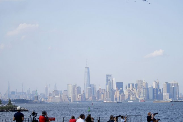 People gather on the Fourth of July last Saturday in New York City to watch a military flyover to celebrate Independence Day. New York and New Jersey on Tuesday expanded their quarantine list for travelers from three additional states. Photo by John Angelillo/UPI