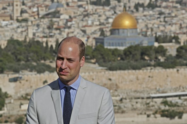 Britain's Prince William stands on Jerusalem's Mount of Olives overlooking the Old City with the golden dome of the Dome of the Rock mosque on June 28, 2018. He turns 39 on June 21. File Photo by Thomas Coex/UPI