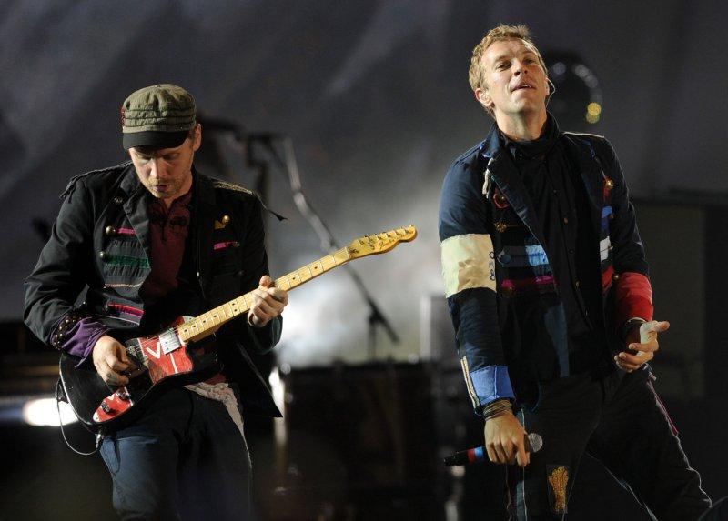 British singer Chris Martin and guitarist Jonny Buckland perform with Coldplay at Wembley Stadium in London on September 18, 2009. UPI/Rune Hellestad