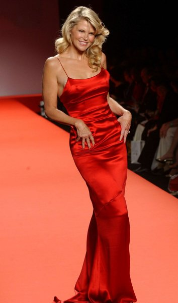 Christie Brinkley wearing Calvin Klein displays the designer outfit at the Red Dress collection 2005 fashion show on 2/4/05 at Olympus Fashion Week in New York. (UPI Photo/Ezio Petersen)