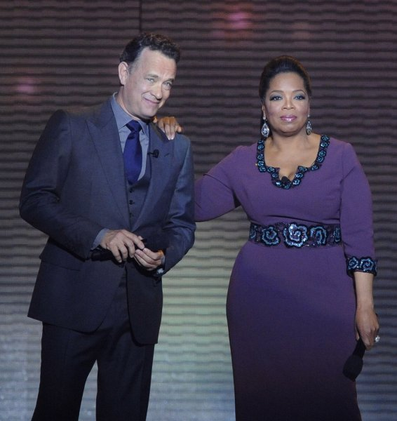 "Oprah Winfrey and Tom Hanks talk to the audience during the taping of ""Surprise Oprah! A Farewell Spectacular"" at the United Center in Chicago on May 17. 2011. The show, which featured several surprise celebrity guests, will air over two days, May 23 and 24. Oprah's final show will be a normal episode of The Oprah Winfrey Show taped at Harpo Studios and will air on May 25. UPI/David Banks"