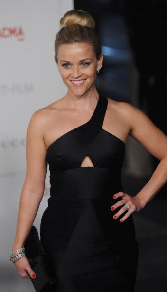 Actress Reese Witherspoon is to be a presenter at Wednesday's CMA Awards in Nashville. UPI/Jim Ruymen