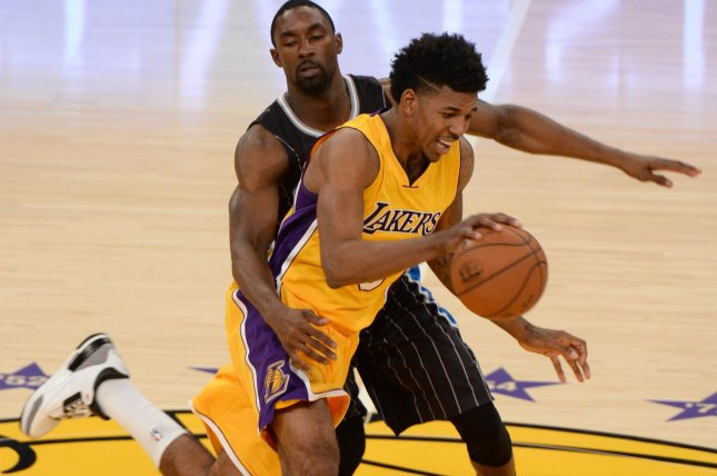 Los Angeles Lakers guard Nick Young (r) dribbles by Orlando Magic guard Ben Gordon during the first half of their NBA game at Staples Center in Los Angeles, January 9, 2015. The Lakers beat the Magic 101-84. UPI/Jon SooHoo