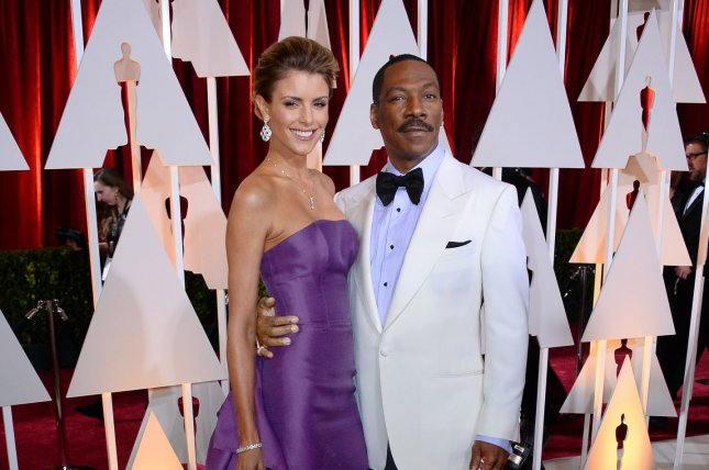 Actor Eddie Murphy and his longtime girlfriend, Australian model Paige Butcher arrive at the 87th Academy Awards at the Hollywood & Highland Center in Los Angeles on Feb. 22, 2015. Murphy recently performed his first stand-up routine in 28 years after he received the Mark Twain Prize for American Humor. During his set Murphy even brought out his famous Bill Cosby impersonation despite declining to do so during 'Saturday Night Lives' 40th anniversary special. File Photo by Jim Ruymen/UPI