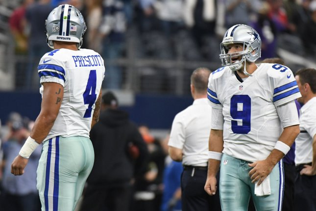 Dallas Cowboys quarterback Tony Romo, right, talks to his former backup Dak Prescott as they warm up prior to facing the Baltimore Ravens on November 20, 2016 at AT&T Stadium in Arlington, Texas. Prescott has started in place of Romo all season.. Ian Halperin/UPI