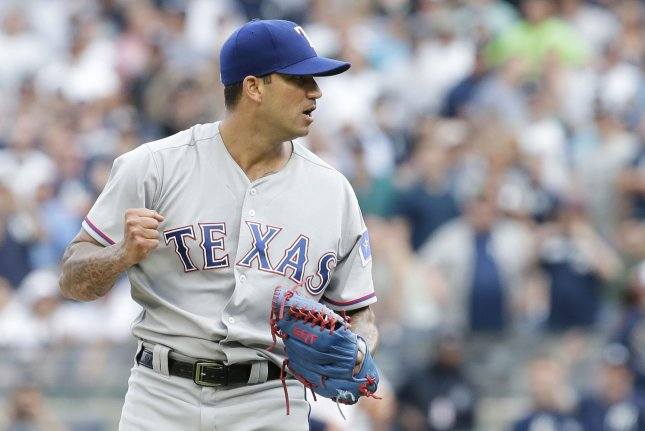Texas Rangers closer Matt Bush reacts after the final out of the 9th inning against the New York Yankees at Yankee Stadium in New York City on June 25, 2017. The Rangers defeated the Yankees 7-6. Photo by John Angelillo/UPI