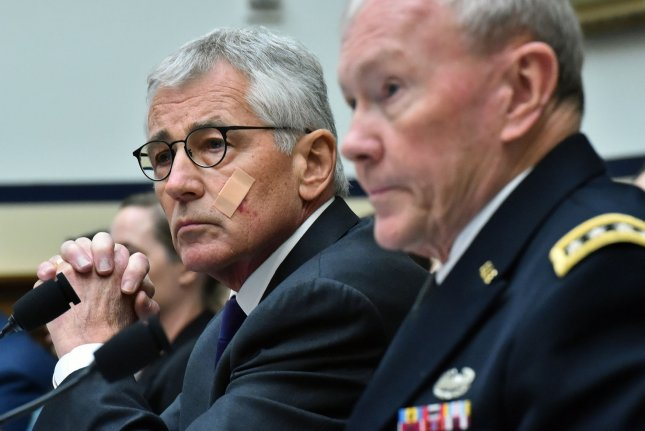Defense Secretary Chuck Hagel testifies alongside Joint Chiefs of Staff Gen. Martin Dempsey during a House Armed Services Committee hearing on the Obama administration's strategy against Islamic State, on Capitol Hill in Washington, D.C. on November 13, 2014. (UPI/Kevin Dietsch)