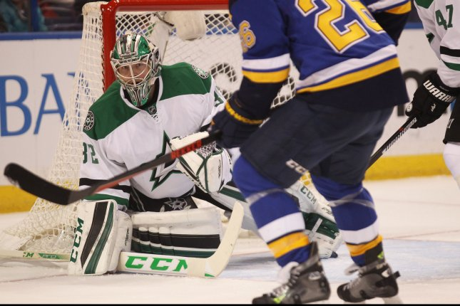 Dallas Stars goaltender Kari Lehtonen of Finland keeps an eye on St. Louis Blues attackers in the first period at the Scottrade Center in St. Louis on February 16, 2016. Photo by Bill Greenblatt/UPI
