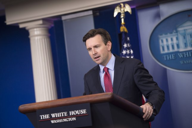 White House Press Secretary Josh Earnest says the government is taking a closer look at an asset deal involving Russian oil company Rosneft. File photo by Kevin Dietsch/UPI