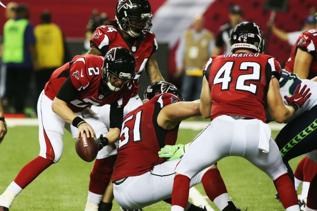 Atlanta Falcons quarterback Matt Ryan maintains control of the ball as a Seattle Seahawks jumps the snap and center Alex Mack falls during their NFC playoff game at the Georgia Dome in Atlanta on January 14, 2017. Falcons won 35-20. Photo by Phil Skinner/UPI