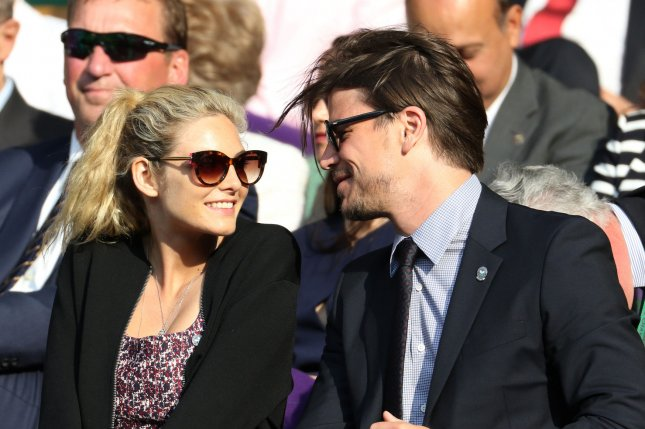 Josh Hartnett (R) and Tamsin Egerton attend the Wimbledon tennis championships in 2015. The couple are expecting their second child. File Photo by Hugo Philpott/UPI