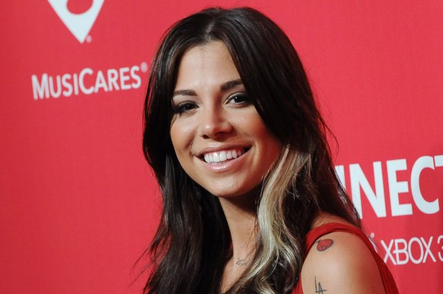 Christina Perri attends the MusiCares Person of the Year tribute to Paul McCartney on February 10, 2012. The singer said yes to Paul Costabile on Wednesday after nearly four years of dating. File Photo by Jim Ruymen/UPI