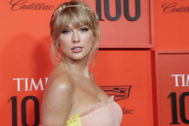 promo code 62d85 9103f Look: Taylor Swift debuts pink-dipped hair, performs at Time ...
