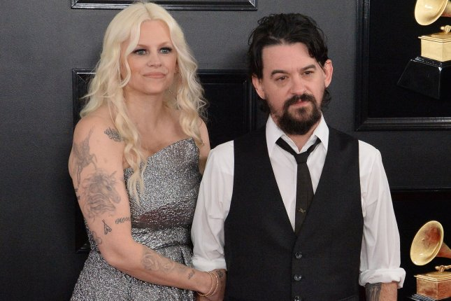 Shooter Jennings (R), seen here with Misty Swain at the 61st annual Grammy Awards on February 10, is joining Guns N' Roses on tour. File Photo by Jim Ruymen/UPI