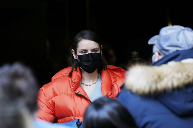 A woman wears a face mask outside after the Michael Kors FW20 Runway Show on Wednesday, in New York City. Photo by John Angelillo/UPI