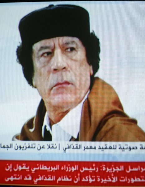 In an image taken from footage broadcast on Al-Jazeera television, shows Libyan leader Moammer Gadhafi gesturing while delivering a nationwide address in Tripoli. Gadhafi says he will stay in Libya despite the bloody showdown between protesters and his security forces. Libyan rebels have reached the highly symbolic Green Square in the center of Tripoli on August 22, 2011. UPI