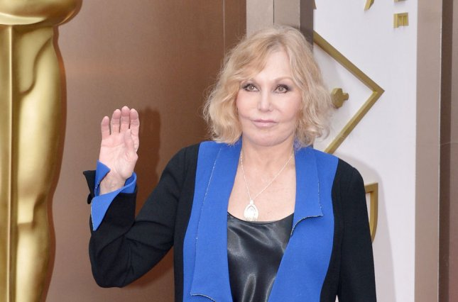 Kim Novak arrives on the red carpet at the 86th Academy Awards at Hollywood & Highland Center in the Hollywood section of Los Angeles on March 2, 2014. UPI/Kevin Dietsch