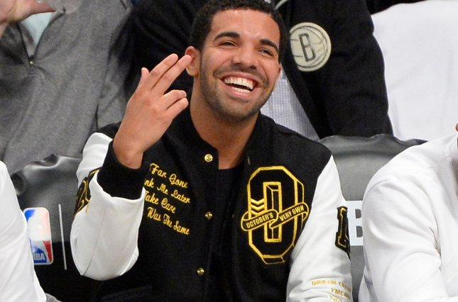Recording artist Drake, seen here last year at an NBA basketball game, has been dubbed this year's most-streamed artist on music application Spotify. File Photo by Rich Kane/UPI
