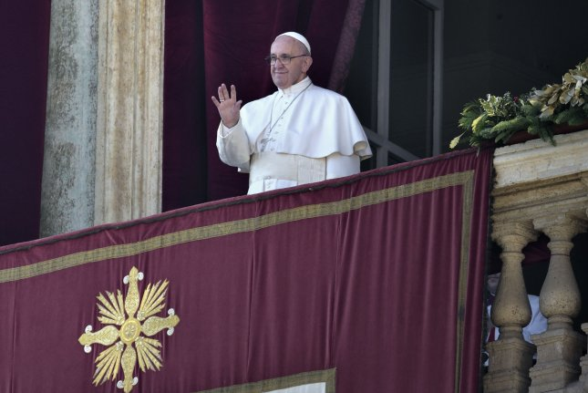 Pope Francis delivers his Christmas day message Urbi et Orbi on Friday at St. Peter's Basilica in Vatican City. The Pope hoped that the recent U.N. resolutions will stop the conflicts in Syria and Libya. Photo by Stefano Spaziani/UPI