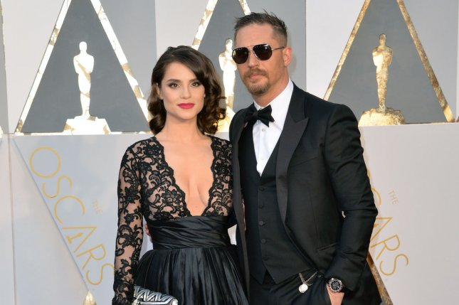 Charlotte Riley (L) and Tom Hardy arrive on the red carpet during the 88th Academy Awards in Los Angeles on February 28, 2016. Riley will soon be seen in the TV version of the play King Charles III. File Photo by Kevin Dietsch/UPI